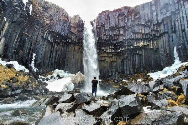 svartifoss-waterfall-man-alone-iceland